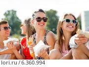 Купить «group of smiling friends sitting on city square», фото № 6360994, снято 20 июля 2014 г. (c) Syda Productions / Фотобанк Лори