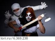 Купить «Halloween concept with mummy and woman with axe», фото № 6369238, снято 16 мая 2013 г. (c) Elnur / Фотобанк Лори