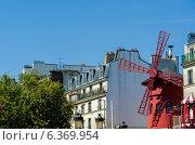 Купить «Paris - JUNE 5: Moulin Rouge Cabaret famous red mill on June 5 in Paris, France. Moulin Rouge Cabaret is the famous cabaret theatre in Paris since 1889», фото № 6369954, снято 15 сентября 2012 г. (c) Elnur / Фотобанк Лори