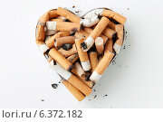 Купить «Cigarette stubs in a metal heart shaped ashtray», фото № 6372182, снято 12 декабря 2018 г. (c) Ingram Publishing / Фотобанк Лори