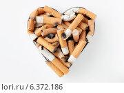Купить «Cigarette stubs in a metal heart shaped ashtray», фото № 6372186, снято 12 декабря 2018 г. (c) Ingram Publishing / Фотобанк Лори