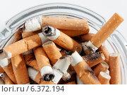 Купить «Overhead view of glass ashtray full of cigarette stubs», фото № 6372194, снято 12 декабря 2018 г. (c) Ingram Publishing / Фотобанк Лори