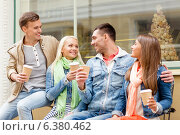 Купить «group of smiling friends with take away coffee», фото № 6380462, снято 14 июня 2014 г. (c) Syda Productions / Фотобанк Лори
