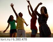 Купить «smiling friends dancing on summer beach», фото № 6380478, снято 3 августа 2014 г. (c) Syda Productions / Фотобанк Лори