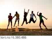 Купить «smiling friends dancing and jumping on beach», фото № 6380486, снято 3 августа 2014 г. (c) Syda Productions / Фотобанк Лори
