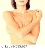 Купить «woman with perfect skin and hands over breast», фото № 6385674, снято 25 июля 2013 г. (c) Syda Productions / Фотобанк Лори