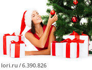 Купить «smiling woman in santa helper hat with gift boxes», фото № 6390826, снято 15 августа 2013 г. (c) Syda Productions / Фотобанк Лори