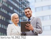 Купить «smiling businessmen with tablet pc outdoors», фото № 6392702, снято 19 августа 2014 г. (c) Syda Productions / Фотобанк Лори
