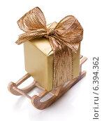 Купить «Luxurious gift in sleds isolated on white background cutout. Christmas decoration.», фото № 6394362, снято 27 августа 2014 г. (c) Natalja Stotika / Фотобанк Лори