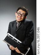 Купить «Comouter geek with computer keyboard», фото № 6397046, снято 21 мая 2014 г. (c) Elnur / Фотобанк Лори
