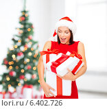 Купить «smiling woman in red dress with gift box», фото № 6402726, снято 15 августа 2013 г. (c) Syda Productions / Фотобанк Лори