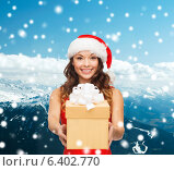 Купить «smiling woman in red dress with gift box», фото № 6402770, снято 22 сентября 2013 г. (c) Syda Productions / Фотобанк Лори