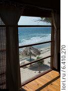 Купить «Beach viewed through from a window of a resort, Utopia Village, Utila Island, Bay Islands, Honduras», фото № 6410270, снято 1 января 2013 г. (c) Ingram Publishing / Фотобанк Лори