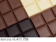 Купить «Плитки шоколада разного вида крупным планом», фото № 6411758, снято 3 сентября 2014 г. (c) Гурьянов Андрей / Фотобанк Лори