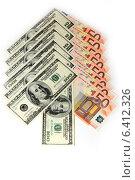 Купить «Стрелка из купюр евро и долларов на белом фоне», фото № 6412326, снято 15 ноября 2012 г. (c) Андрей Бурдюков / Фотобанк Лори