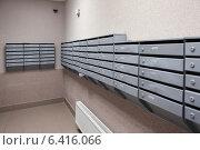 Купить «Почтовые ящики в лифтовом холле жилого дома», фото № 6416066, снято 3 августа 2014 г. (c) Кекяляйнен Андрей / Фотобанк Лори