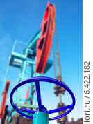 Купить «Нефтяной вентиль с качалкой на заднем плане», фото № 6422182, снято 28 октября 2011 г. (c) Икан Леонид / Фотобанк Лори