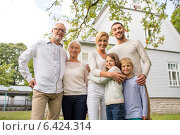 Купить «happy family in front of house outdoors», фото № 6424314, снято 21 августа 2014 г. (c) Syda Productions / Фотобанк Лори