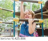girl developing dexterity at playground. Стоковое фото, фотограф Яков Филимонов / Фотобанк Лори