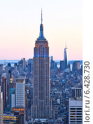 Купить «Cityscape view of Manhattan with Empire State Building at sunset», фото № 6428730, снято 1 апреля 2014 г. (c) Николай Охитин / Фотобанк Лори