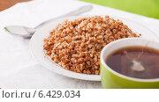 Купить «boiled buckwheat porridge», фото № 6429034, снято 18 ноября 2012 г. (c) Яков Филимонов / Фотобанк Лори