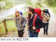 Купить «group of smiling friends with backpacks hiking», фото № 6432154, снято 31 августа 2014 г. (c) Syda Productions / Фотобанк Лори