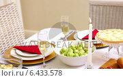 Купить «Christmas dinner table with food», видеоролик № 6433578, снято 15 сентября 2019 г. (c) Wavebreak Media / Фотобанк Лори