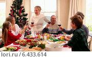 Купить «Three generation family having christmas dinner together», видеоролик № 6433614, снято 23 августа 2019 г. (c) Wavebreak Media / Фотобанк Лори