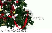 Купить «Christmas tree with many gifts», видеоролик № 6433678, снято 15 сентября 2019 г. (c) Wavebreak Media / Фотобанк Лори