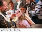 Купить «Крещение ребенка», фото № 6438966, снято 21 сентября 2014 г. (c) EugeneSergeev / Фотобанк Лори
