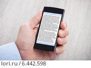 Купить «Businessman's Hand Displaying eBook On Smartphone», фото № 6442598, снято 25 марта 2014 г. (c) Андрей Попов / Фотобанк Лори