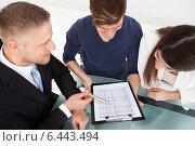 Купить «Financial Advisor Explaining Investment Plan To Couple», фото № 6443494, снято 30 марта 2014 г. (c) Андрей Попов / Фотобанк Лори