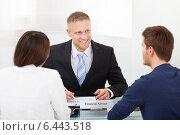 Купить «Couple Consulting Financial Advisor», фото № 6443518, снято 30 марта 2014 г. (c) Андрей Попов / Фотобанк Лори