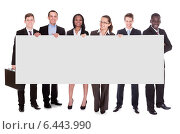 Купить «Business Team Holding Blank Placard», фото № 6443990, снято 25 мая 2020 г. (c) Андрей Попов / Фотобанк Лори