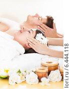 Купить «Couple Receiving Head Massage», фото № 6444118, снято 30 марта 2014 г. (c) Андрей Попов / Фотобанк Лори