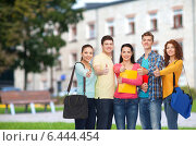 group of smiling teenagers showing thumbs up. Стоковое фото, фотограф Syda Productions / Фотобанк Лори