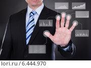 Купить «Businessman touching the screen», фото № 6444970, снято 7 апреля 2013 г. (c) Андрей Попов / Фотобанк Лори