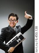 Купить «Comouter geek with computer keyboard», фото № 6450138, снято 21 мая 2014 г. (c) Elnur / Фотобанк Лори