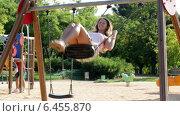 Купить «Girl in skirt on swing in summer», видеоролик № 6455870, снято 28 сентября 2014 г. (c) Яков Филимонов / Фотобанк Лори