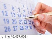 Купить «Hand Marking Date 15 On Calendar», фото № 6457602, снято 31 мая 2014 г. (c) Андрей Попов / Фотобанк Лори