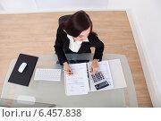 Купить «Happy Businesswoman Calculating Tax», фото № 6457838, снято 15 марта 2014 г. (c) Андрей Попов / Фотобанк Лори