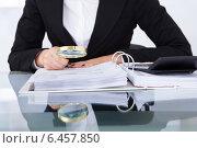 Купить «Auditor Scrutinizing Financial Documents», фото № 6457850, снято 15 марта 2014 г. (c) Андрей Попов / Фотобанк Лори
