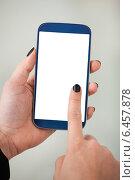 Купить «Businesswoman's Hand Holding Smartphone», фото № 6457878, снято 15 марта 2014 г. (c) Андрей Попов / Фотобанк Лори