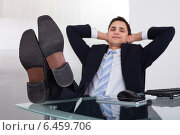 Купить «Relaxed Businessman Daydreaming In Office», фото № 6459706, снято 10 апреля 2014 г. (c) Андрей Попов / Фотобанк Лори
