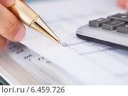 Купить «Businessman Checking Expense In Office», фото № 6459726, снято 10 апреля 2014 г. (c) Андрей Попов / Фотобанк Лори
