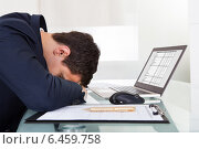 Купить «Tired Businessman Sleeping While Calculating Expenses In Office», фото № 6459758, снято 10 апреля 2014 г. (c) Андрей Попов / Фотобанк Лори