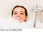 Купить «Smiling girl laying in bathtub», фото № 6460094, снято 23 июля 2018 г. (c) Яков Филимонов / Фотобанк Лори