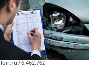 Купить «Insurance Agent Examining Car After Accident», фото № 6462762, снято 28 июня 2014 г. (c) Андрей Попов / Фотобанк Лори