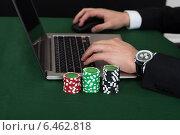 Купить «Businessman Using Laptop By Stacked Poker Chips», фото № 6462818, снято 28 июня 2014 г. (c) Андрей Попов / Фотобанк Лори