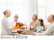 Купить «smiling family having holiday dinner at home», фото № 6470018, снято 14 сентября 2014 г. (c) Syda Productions / Фотобанк Лори